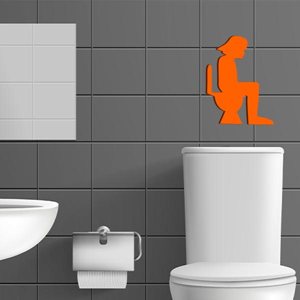 plaque murale en métal dark vador dans les toilettes en orange