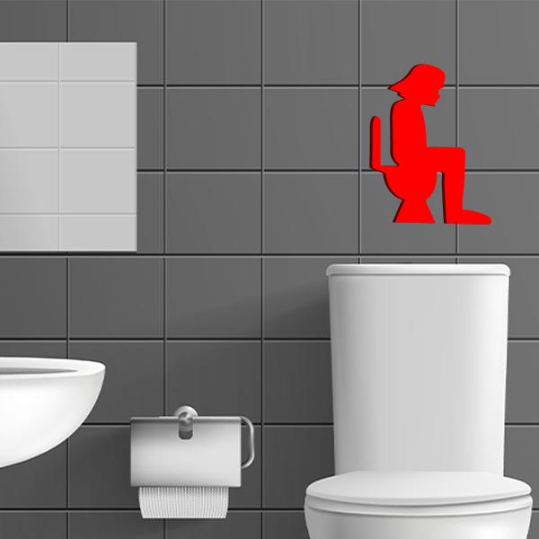 plaque murale en métal dark vador dans les toilettes en rouge