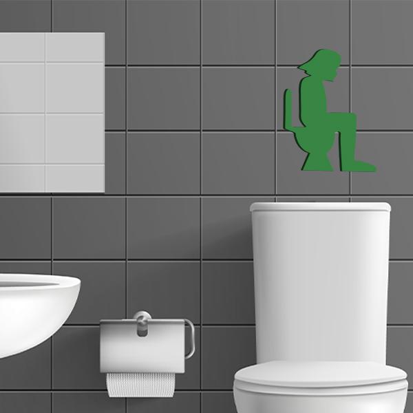 plaque murale en métal dark vador dans les toilettes en vert