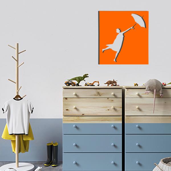 cadre mural en métal ajouré de mary poppins dans la chambre d'enfant en orange