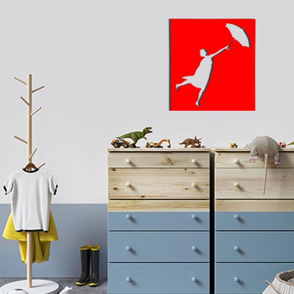 cadre mural en métal ajouré de mary poppins dans la chambre d'enfant en rouge