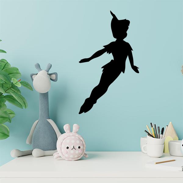 plaque murale metal peter pan dans chambre d'enfant en noir