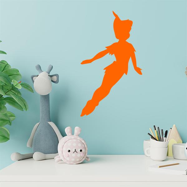 plaque murale metal peter pan dans chambre d'enfant en orange