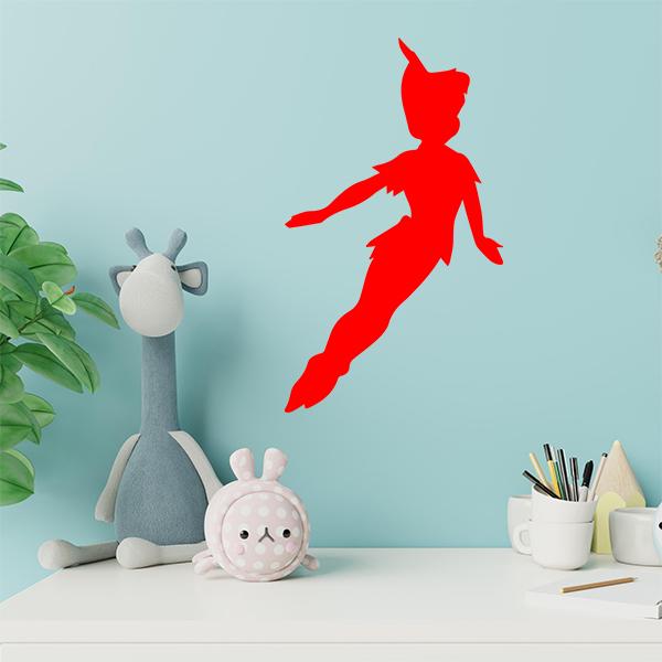 plaque murale metal peter pan dans chambre d'enfant en rouge