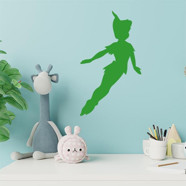 plaque murale metal peter pan dans chambre d'enfant en vert