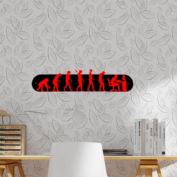 plaque murale en métal évolution humaine ordi noir et rouge dans bureau