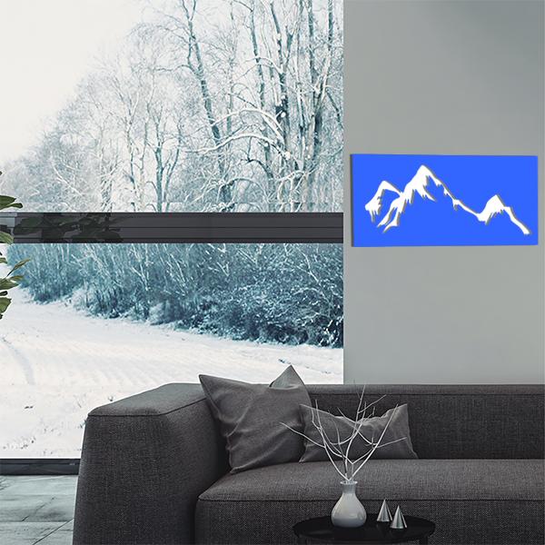 cadre mural en métal montagne dans salon en bleu et fond blanc