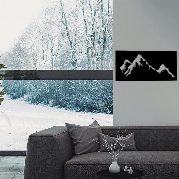 cadre mural en métal montagne dans salon en noir