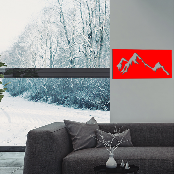 cadre mural en métal montagne dans salon en rouge