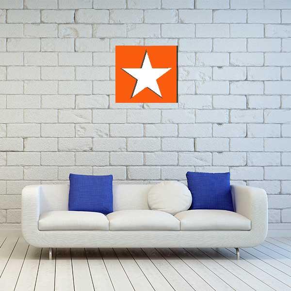 cadre mural metal etoile orange fond blanc salon