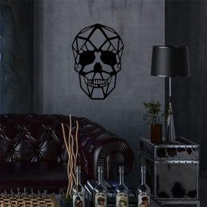plaque murale métal tête de mort dans le salon en noir