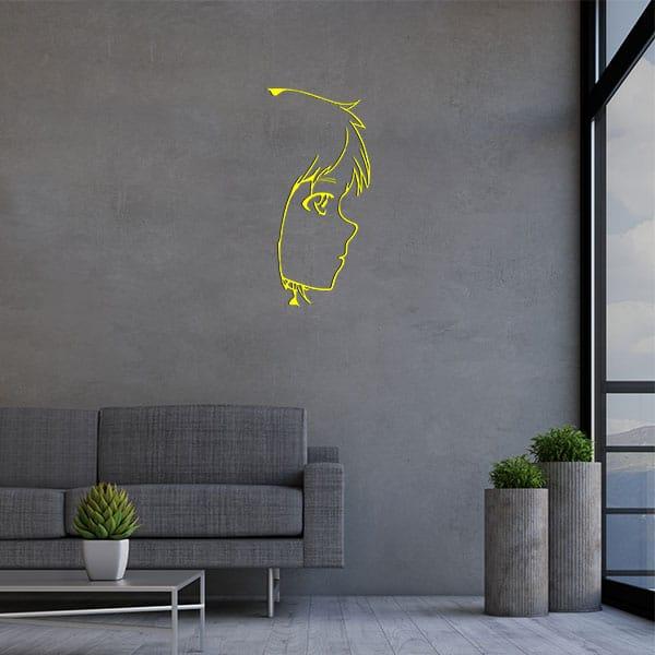 plaque murale metal tete fille jaune salon